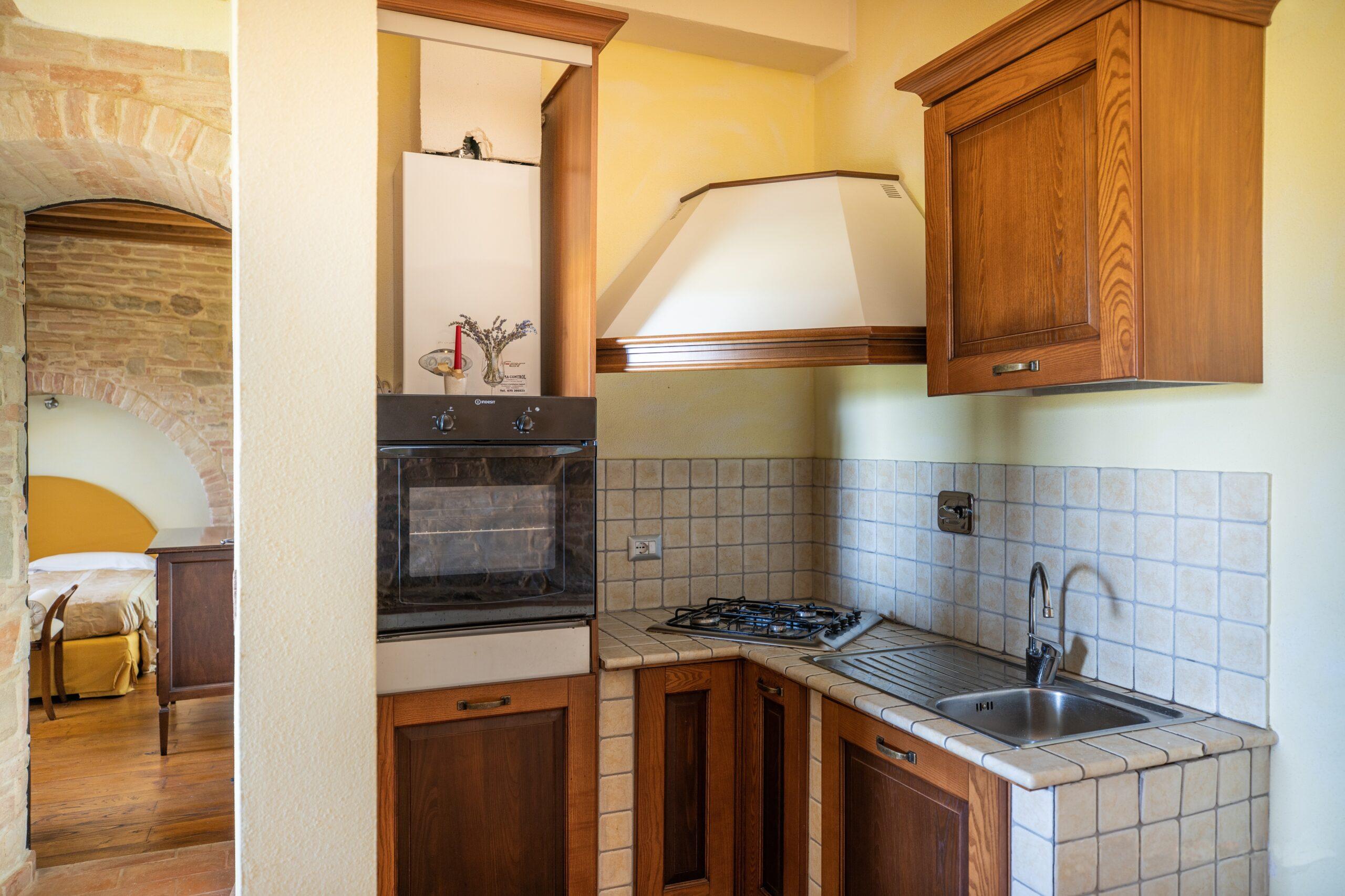 Appartamento con cucina e forno